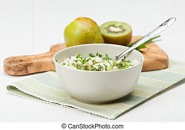Homemade Salsa Made Of Kiwi, Pears, Chives And Mint. Olive Wood