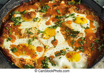 Homemade Saucy Shakshuka with Eggs Cilantro and Tomatoes