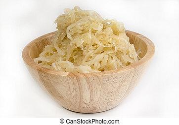 homemade sauerkraut in a wooden bowl