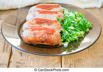 Homemade sausages on a plate with greens on a rustic table.