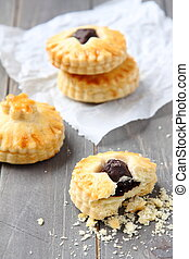 Homemade shortbread cookies with chocolate on wooden background