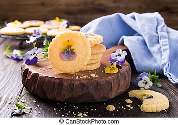 Homemade shortbread cookies with edible flowers on old ...