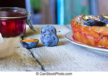 Homemade shortcrust plum cake (pie) rustic on wooden background. Autumn fruit crumble pastry..