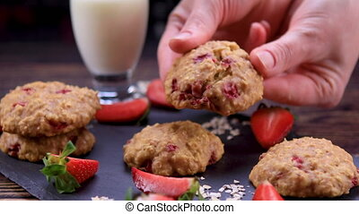 Homemade strawberry oatmeal cookies - Woman hands breaking ...