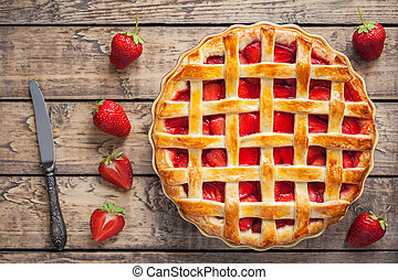 Homemade strawberry tart pie cake traditional pastry food with knife