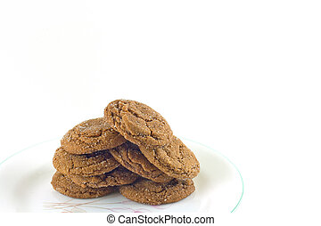 Homemade sugared molasses cookies on a white background.
