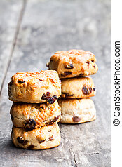 Homemade  sultana scones on wooden table