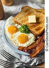 Homemade Sunnyside Eggs Breakfast with Toast and Bacon