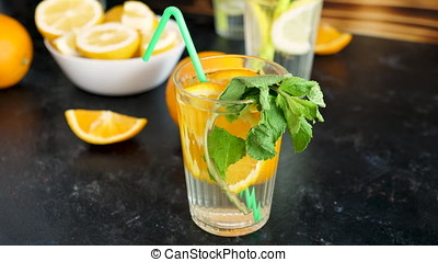 Homemade sweet and delicious orangeade with mint in a glass...