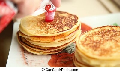 Homemade sweet pancakes with fruit jam,
