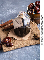 Homemade syrup from dates. Alternative food and drink trend food Vertical.