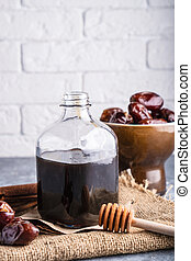 Homemade syrup from dates. Alternative food and drink trend food Vertical