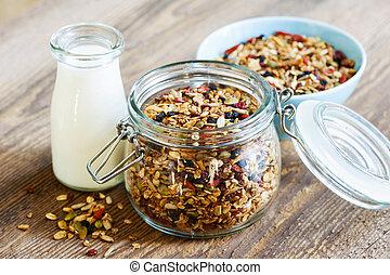 Homemade toasted granola - Homemade granola in open glass...