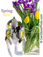rabbit near a bouquet of spring flowers