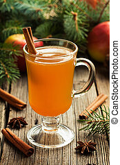 Homemade traditional winter hot apple cider with cinnamon stick, anise and spices. Thanksgiving or christmas holiday healthy celebration beverage.
