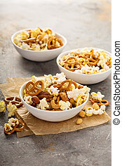 Homemade trail mix with popcorn, pretzels and nuts