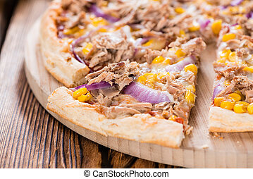 Homemade Tuna Pizza (with corn and red onions) on wooden...