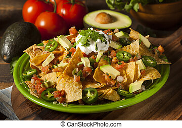 Homemade Unhealthy Nachos with Cheese and Vegetables -...