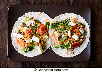 Homemade Vegetarian Tostadas with Salad, Cheese and Grated...