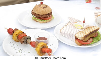 Homemade veggie burger served on wooden table.