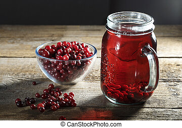 cranberry juice and fresh cranberries on the table