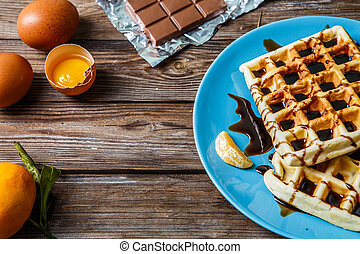 Homemade wafers on blue plate
