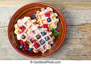 Homemade waffles with fresh berry fruit