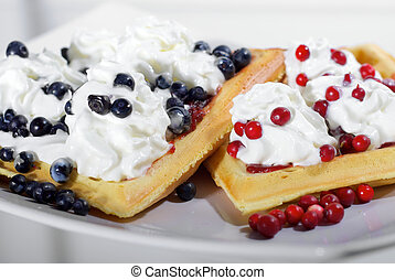 Homemade waffles with fresh blueberries and cranberries