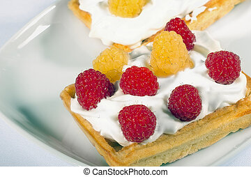 Homemade waffles with fresh raspberrries