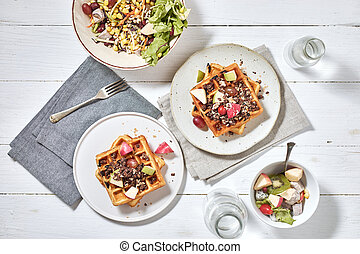 Homemade waffles with fruit and granola.