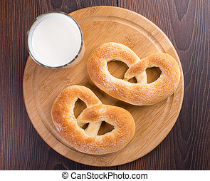 Homemade warm soft pretzels and glass of milk