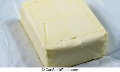 Homemade white butter in open packaging. Closeup