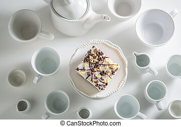 Homemade white cake with mousse, chocolate and porcelain