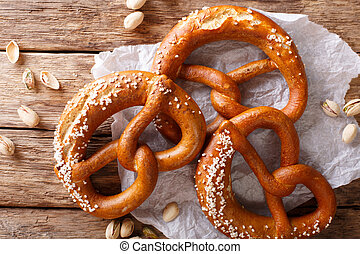 Homemade whole meal pretzels with salt close-up on the table. horizontal top view