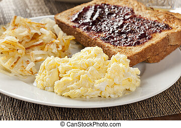 Homemade Wholesome American Breakfast with eggs, toast, and hashbrowns