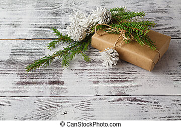 Homemade wrapped christmas present on wooden surface