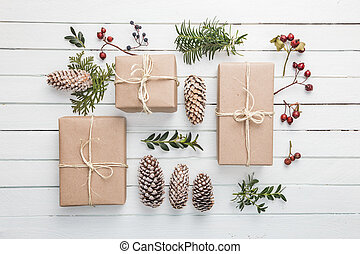 Homemade wrapped rustic brown paper packages with various...