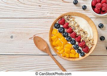 homemade yogurt bowl with raspberry, blueberry, mango and granola