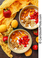 Homemade yogurt with granola, apricot and pine nuts -...