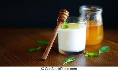 homemade yogurt with honey on wooden background