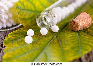 Homeopathic globules - Homeopathic lactose sugar globules on...