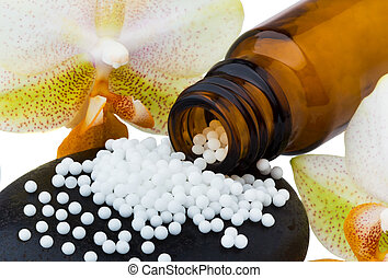 Homeopathy. Globules as alternative medicine. Lying on a ...