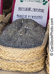 Homeopathy, wicker baskets stuffed medicinal healing herbs
