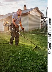 Homeowner Cuts his Grass with a String Trimmer