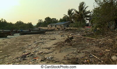 Homes and Boats on Debris-Filled Beach - Handheld, panning,...