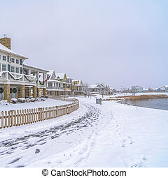 Homes in front of a lake viewed during winter
