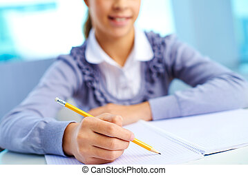Close-up image of a girl doing her homework
