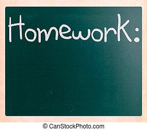 """Homework"" handwritten with white chalk on a blackboard"