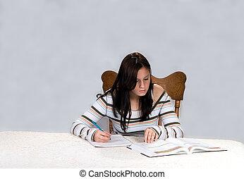 Homework - Teenage girl studying