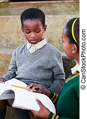 Homework - The girl are helping her little brother with his ...